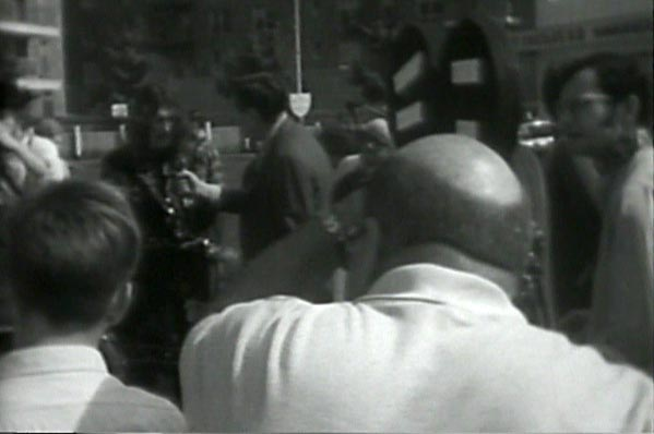 Joey Skaggs surrounded by news media during the Hippie Bus Tour to Queens Event, September 22, 1968