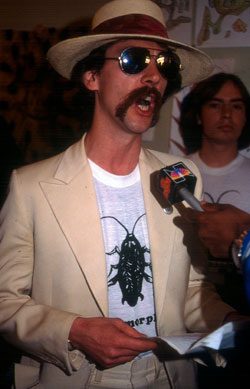 Dr. Josef Gregor (aka Joey Skaggs) at his Metamorphosis press conference, 1981