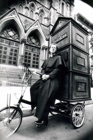Father Joseph (aka Joey Skaggs) with his mobile confessional booth, Portofess