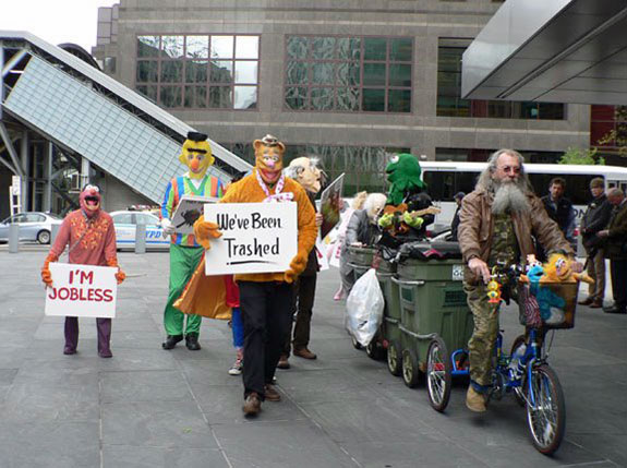 Joey Skaggs' Mobile Homeless Homes protest approaches Goldman Sachs in New York City