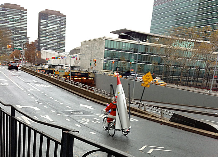 Joey Skaggs as Santa approaches the United Nations during his Santa's Missile Tow protest